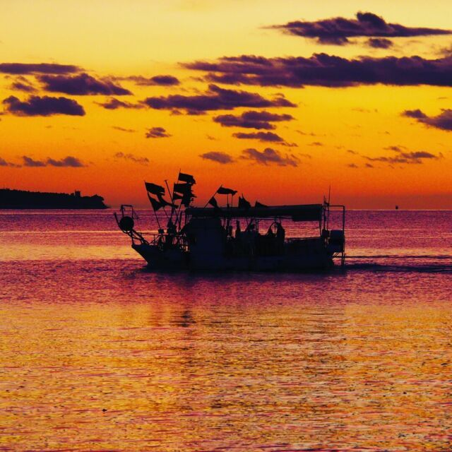 a boat into sunset…