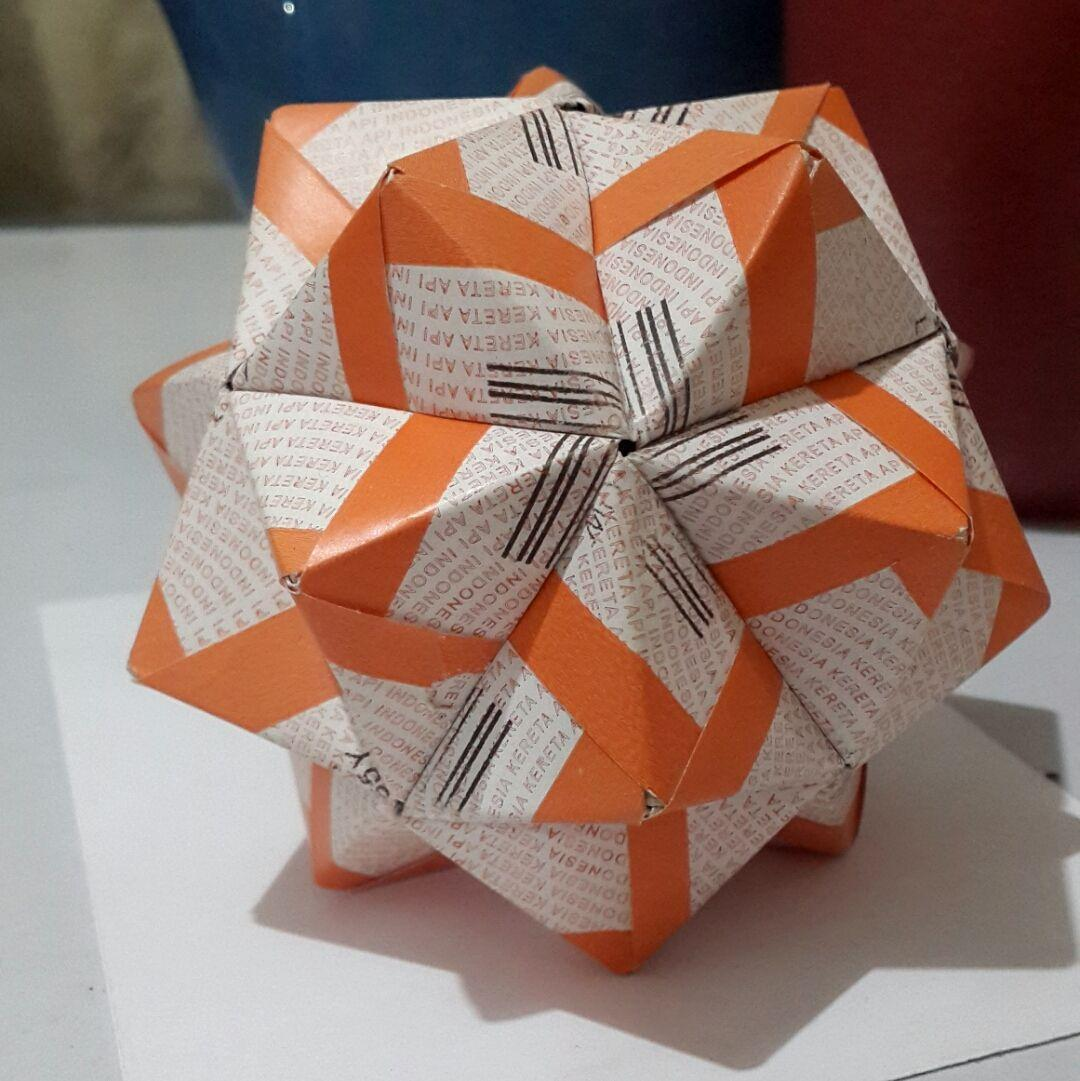 An icosahedron made of thirty sonobe modules, each folded from an orange and white ticket stub.